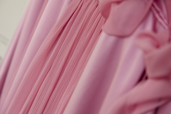 Close up of pink bridesmaid dresses