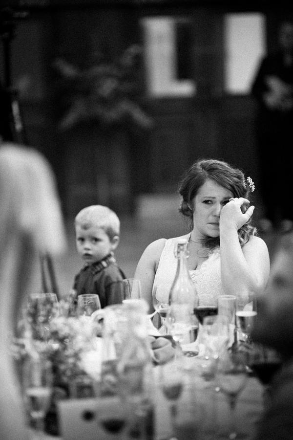 Woman wiping tear away