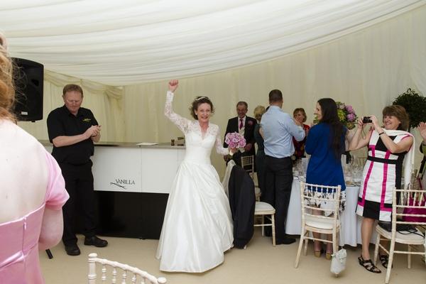 Bride entering wedding breakfast