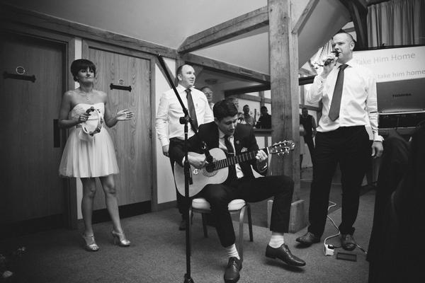 Guitar player at wedding for speech
