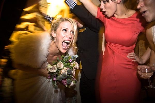 Bride ducking through friends