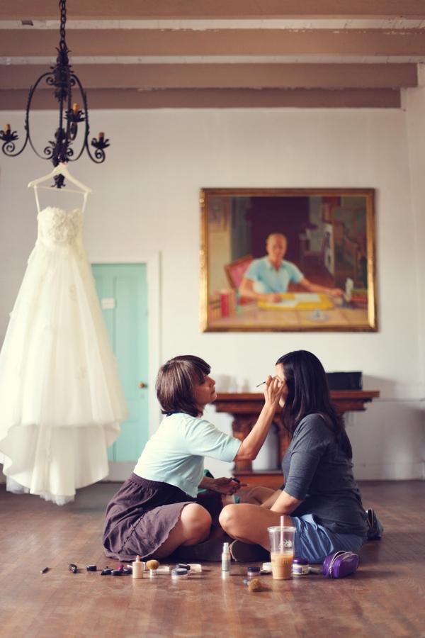 Bridesmaids doing make-up