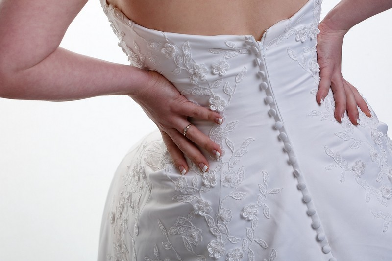 Bride trying on wedidng dress