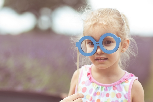 Child Posing with Glasses