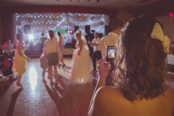 Taking picture of wedding guests dancing