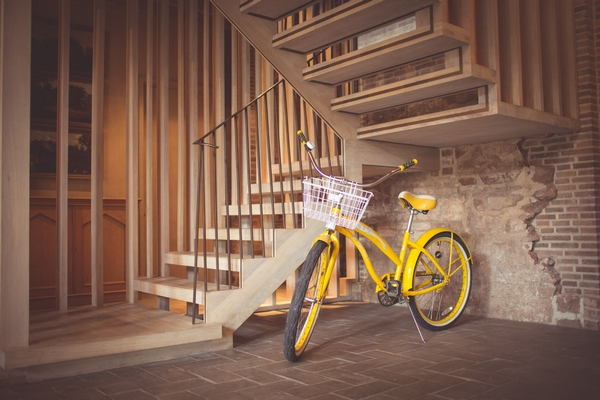 Yellow bicycle at bottom of stairs