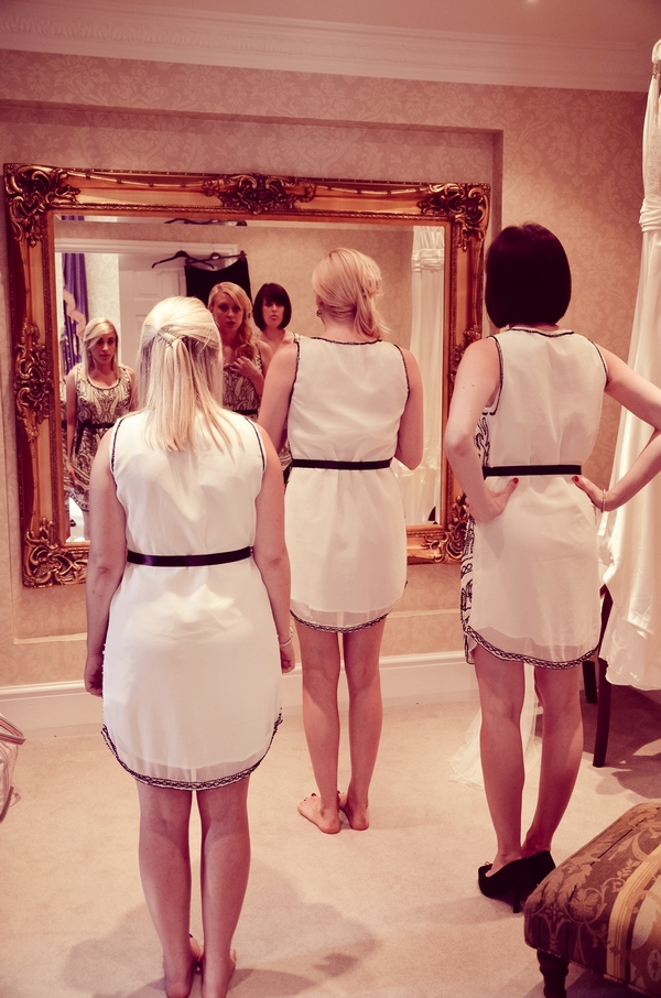 Bridesmaids looking in the mirror