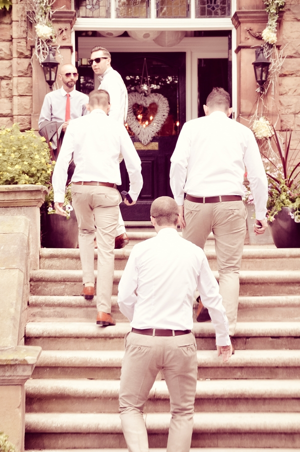 Groomsmen walking up steps