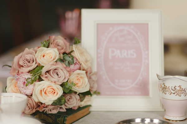 Flowers and pink table name sign