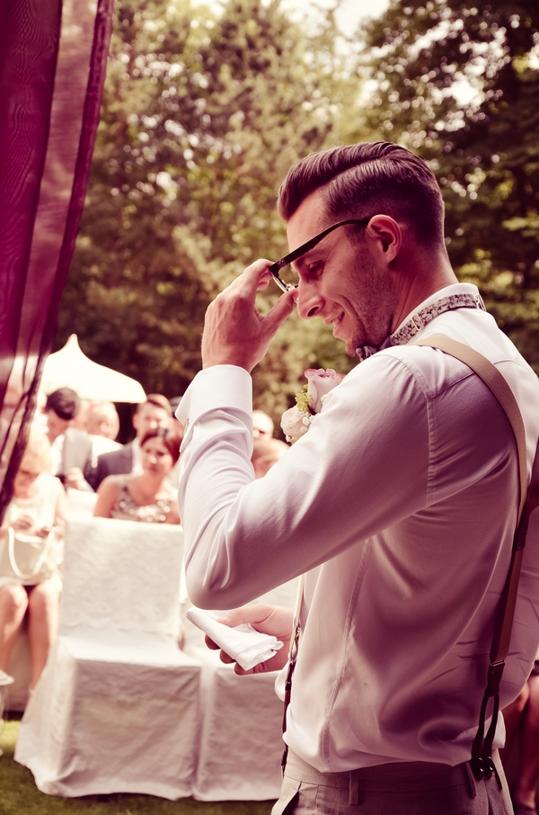 Groom taking off glasses