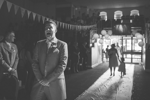 Groom pulling funny face waiting for bride