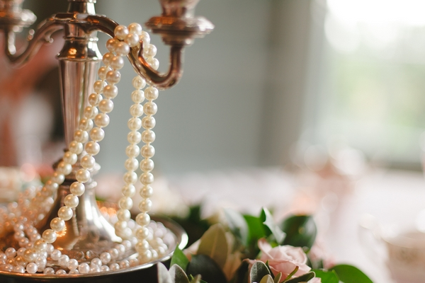Pearls over candle stick
