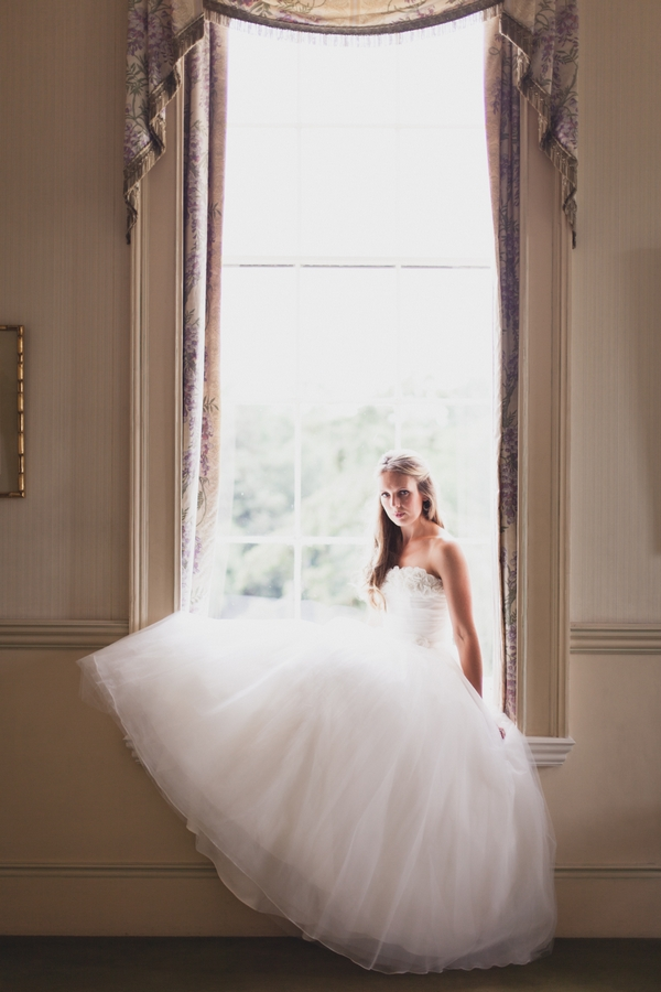 Bride sitting in window