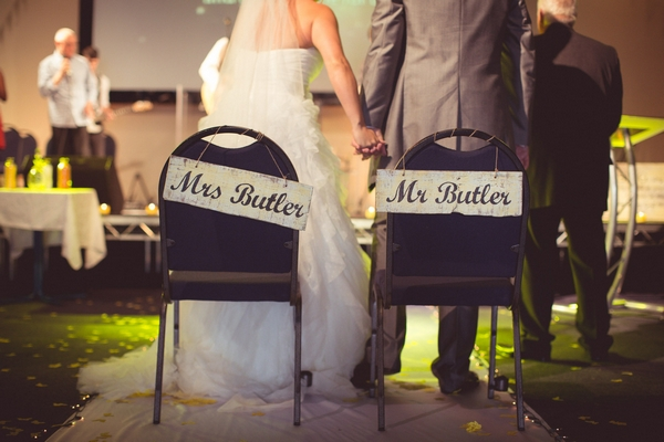 Bride and groom with Mr and Mrs chairs