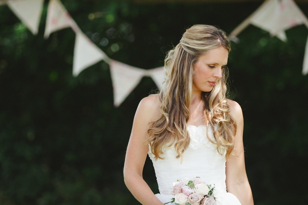 Bride standing in front of bunting