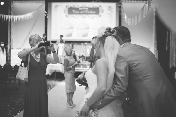 Guest taking picture of bride and groom