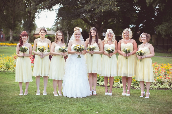 Bride with bridesmaids in yellow dresses