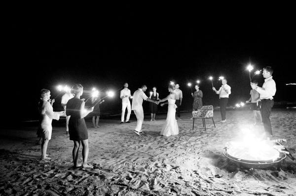 Bride and groom dance on beach