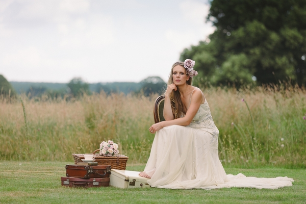 Bride sitting with vintage props