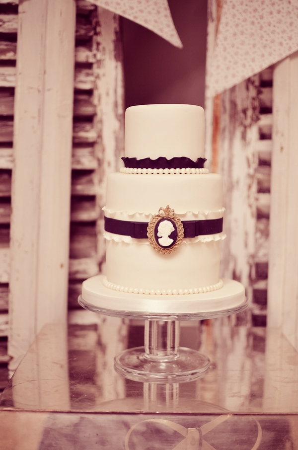 Tiered wedding cake with black ribbon