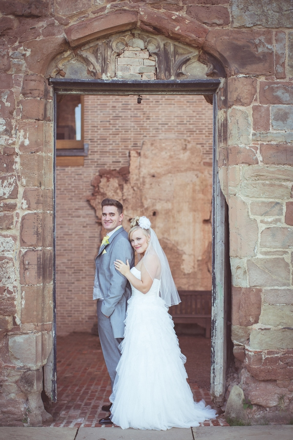 Bride and groom in doorway of Astley Castle
