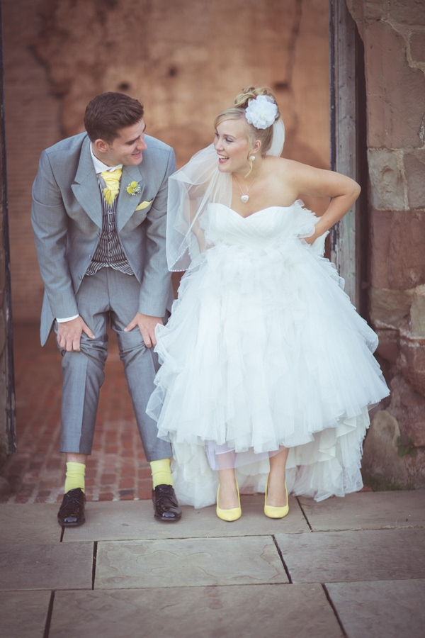 Bride and groom revealing yellow socks and shoes