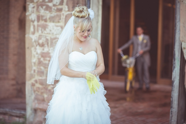 Bride putting on yellow gloves