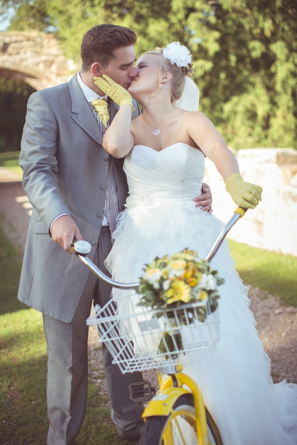 Bride and grom with yellow bike