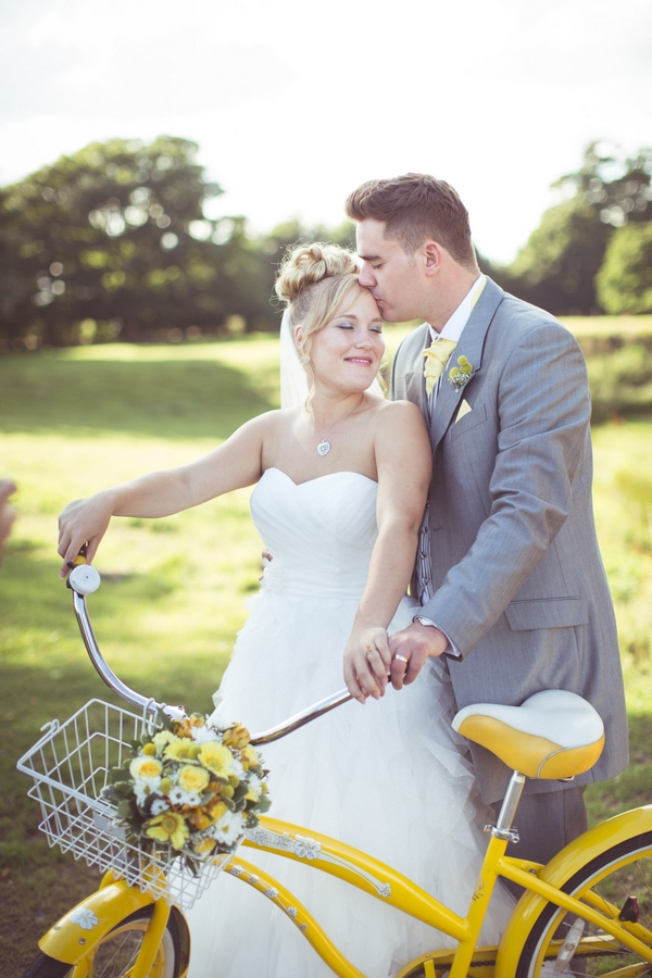 Bride and groom with yellow bike