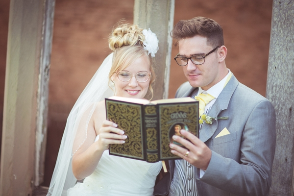 Bride and groom reading book