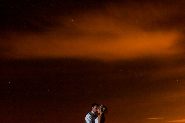 Bride and groom with orange sky - Picture by Photos by Jessica