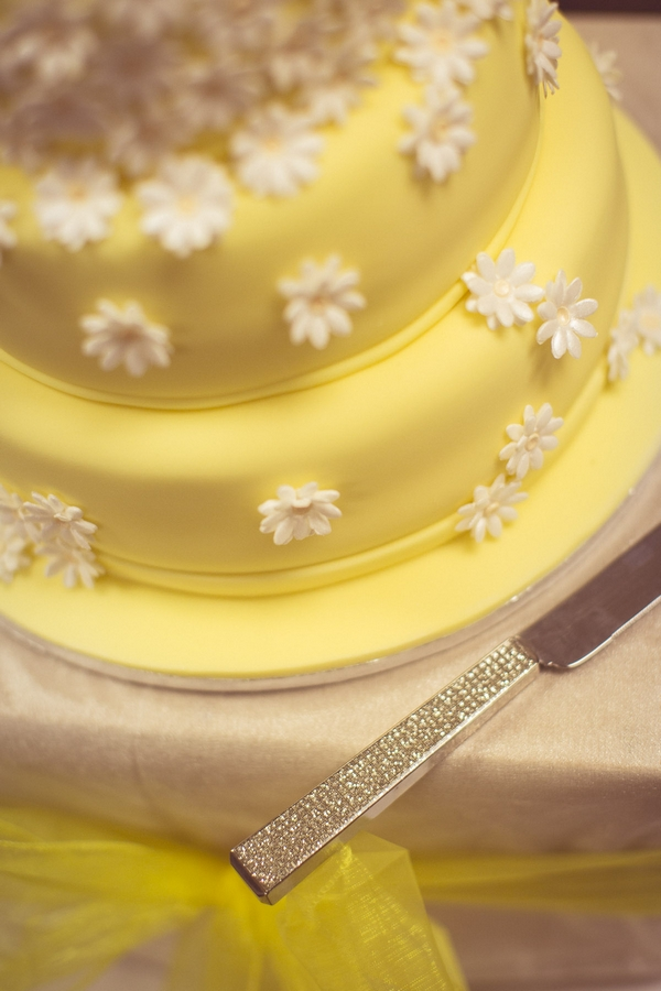 Flower detail on yellow wedding cake