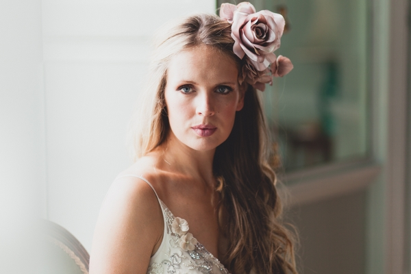 Bride with large flower in hair