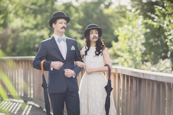 Bride and groom with fake moustaches and bowler hats