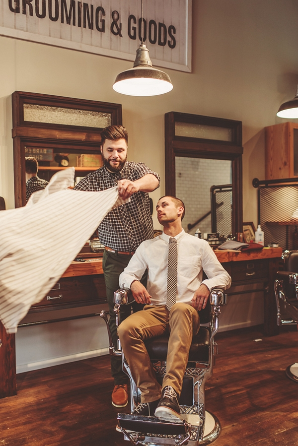 Man sitting in barber's chair