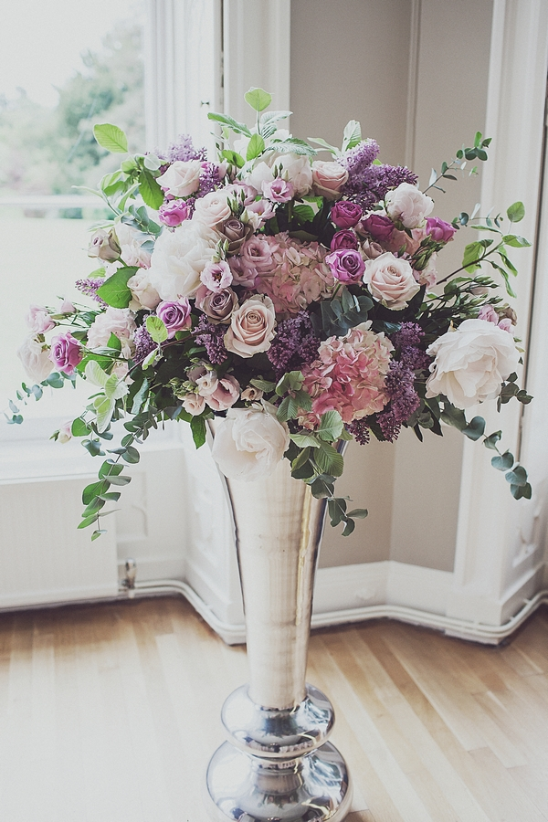 Tall vase of wedding flowers