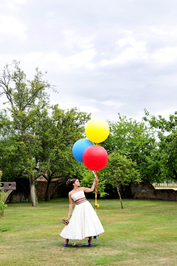 Bride holding coloured balloons