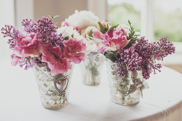 Small vases of wedding flowers