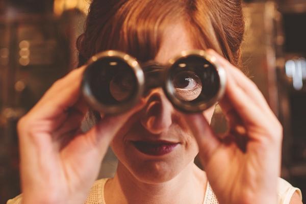 Bride looking through binoculars