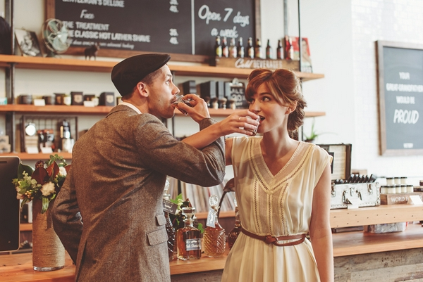 Vintage bride and groom drinking whisky