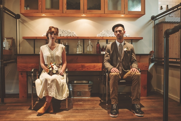 Vintage bride and groom sitting on chairs