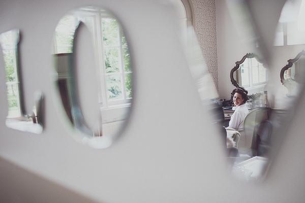 Bride's reflection in LOVE mirror