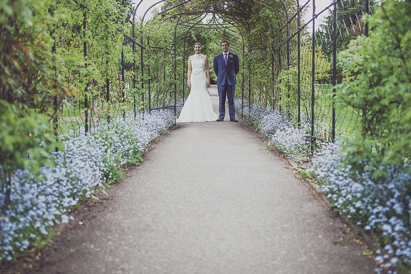 Bride and groom in garden of Nonsuch Mansion