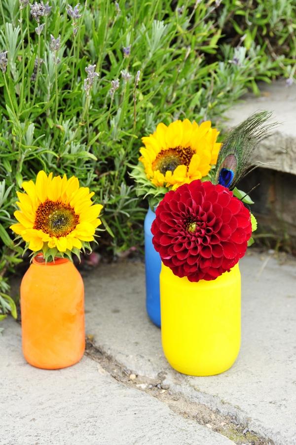 Coloured bottles of flowers