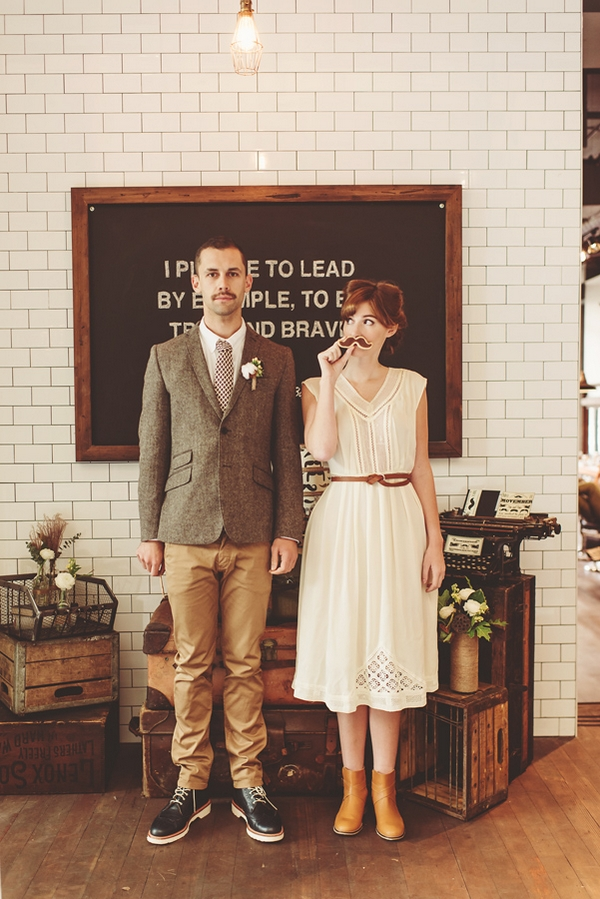 Bride holding up fake moustache