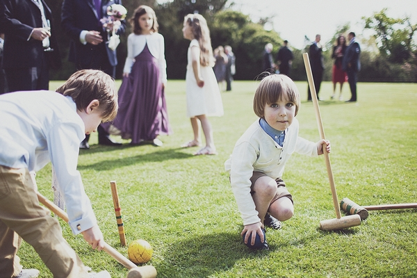 Children playing croquet