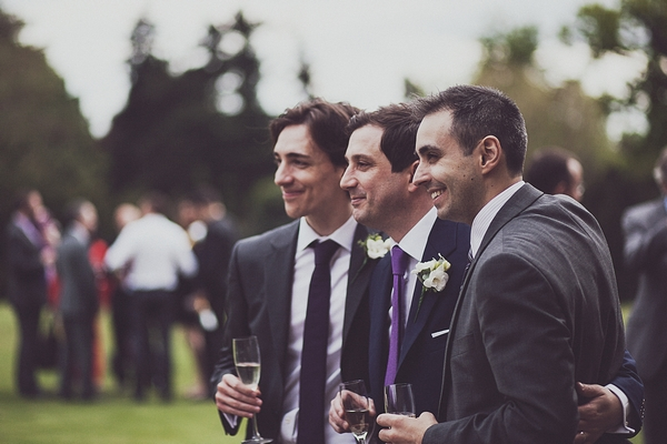 Groom standing with friends