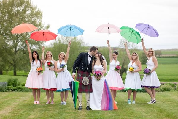 Bridesmaids with coloured umbrellas