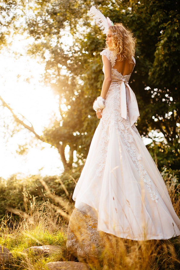 Boho bride with feather in hair