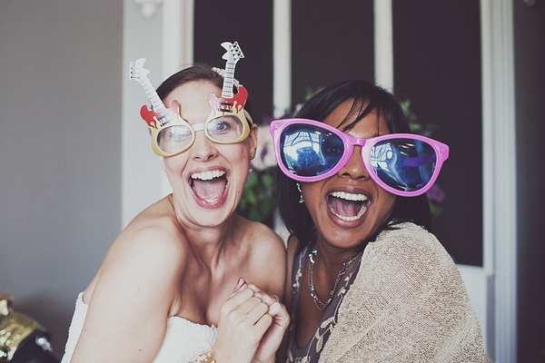Wedding guests wearing funny glasses